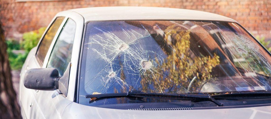 Broken car glass. Few blows to glass